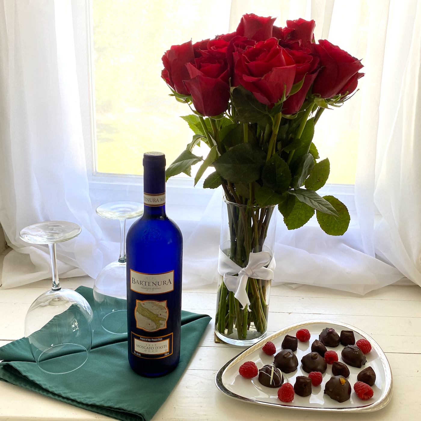 Wine, roses, and chocolate truffles to enhance the experience at our B&B.