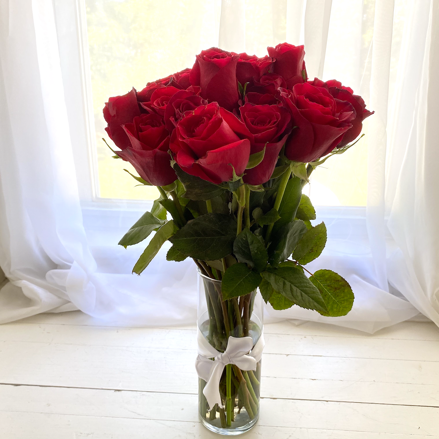 A dozen red roses to show your love while on a romantic getaway in Virginia.